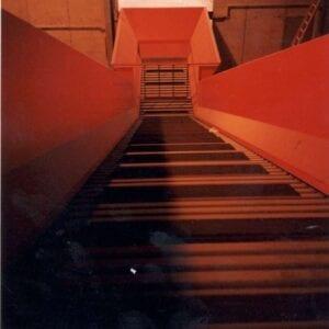 Above floor steel belt loading conveyor