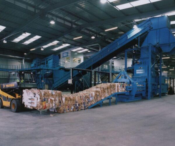 Conveyor and baler feed