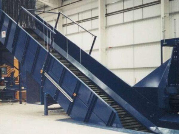 Infloor baler feed steel belt conveyor